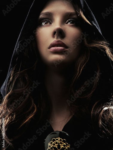 Portrait of a mysterious woman in hood