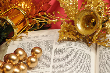 Bible open to the Christmas text with festive decorations