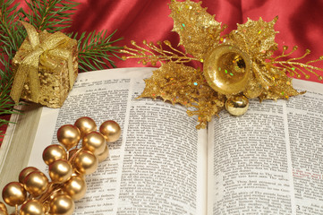 Bible open to Christmas passage with gold decorations