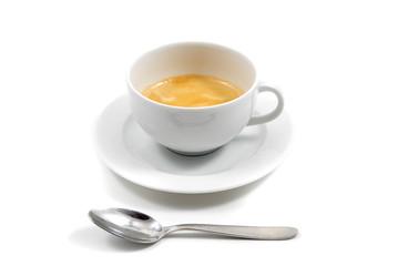 Tazzina di caffè con cucchiaino di fronte