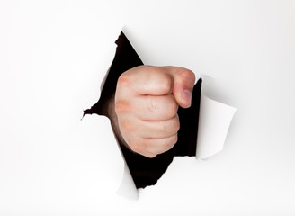Fist punching a hole through the background