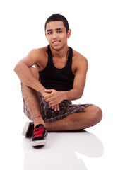 young and handsome latin man, seated on floor