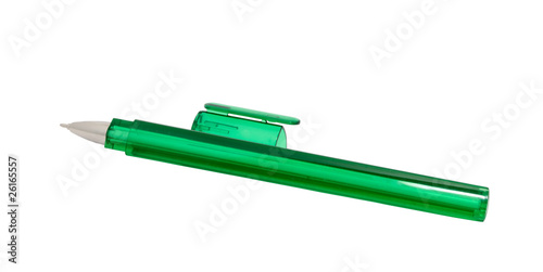 green pen on a white background