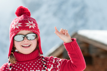 Little girl in winter resort