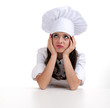 sad, thoughtful female cook in white uniform and hat .