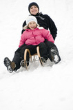 Sledding at winter time poster