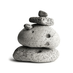 Pebble stones tower isolated, monochrome photo.