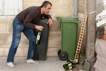 drunk man near bin