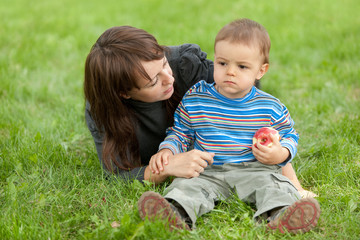 Caring mother and her sonny in the park