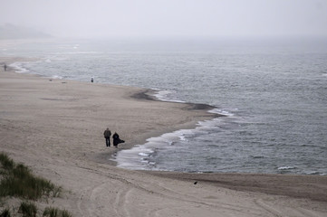 Couple on the autumn beach, Curonian Lagoon