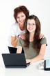 smart mom and daughter using laptop
