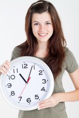 teen beauty holding clock