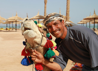 Bedouin smile portrait with camel