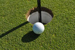 golf ball at the cup