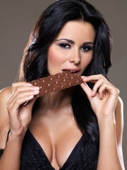 Portrait of sexy woman, she holding chocolate bar