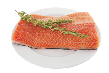 salmon fillet on white plate and rosemary