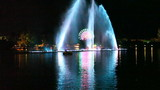 Nightlife entertainment,fountains in a lake poster