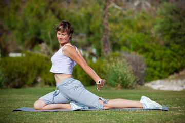 Woman stretching while practicing yoga