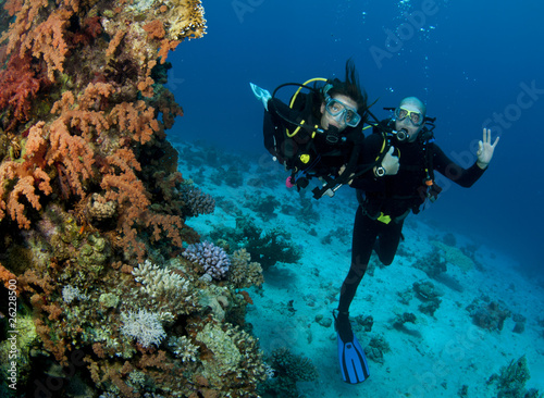 scuba divers having fun and give OK sign
