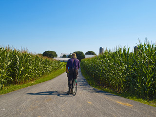 Amish Farmer riding a bicycle