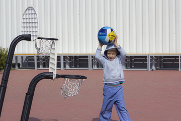 kid plays basketball