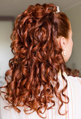 Wedding hair style with long red curly hair