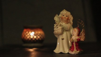 Vintage christmas angels and candles in the night