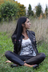 Portrait of beautiful woman sitting on grass