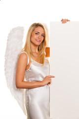 Engel zu Weihnachten mit leerer Tafel für Wünsche