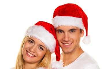 Paar zu Weihnachten mit Mützen des Weihnachtsmannes
