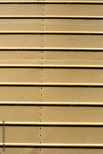 Painted metal surface with rivets
