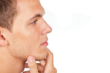 Closeup portrait of a thoughtful man with hand on his chin