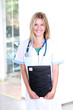 blond medical doctor woman with stethoscope