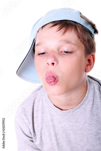 Boy in cap showing his tongue