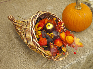 Harvest arrangement with pumpkin and cornucopia