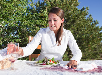 Woman trying to clean after spilling wine