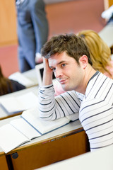 Bored male student during an university lesson