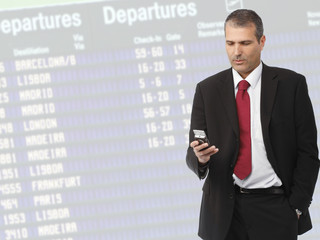 businessman calling on mobile phone on airport