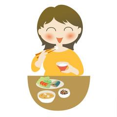 食事をする女性──和食