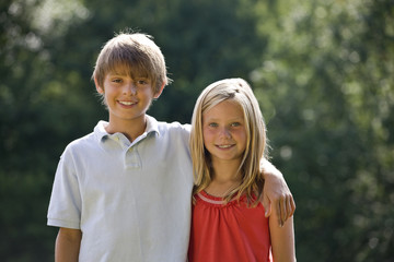 Portrait of a young boy and girl smiling