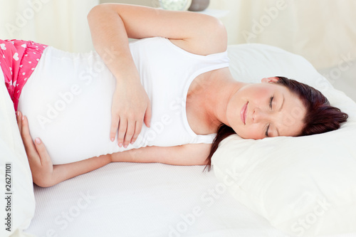 Radiant pregnant woman sleeping in her bed