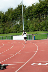 Sporty male sprinter training