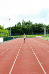Athletic male sprinter training
