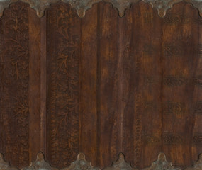 Wood and metal carved scroll work background