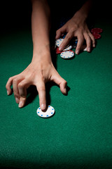 Female Hands Grabbing Poker Chips