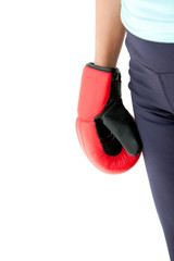 Close-up of the fist of a hispanic woman wearing boxing gloves