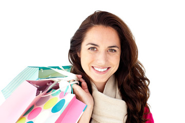 Radiant hispanic woman wearing a scarf and holding shopping bags