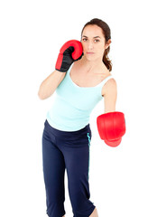 Sporty hispanic woman with boxing gloves working out
