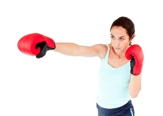 Athletic hispanic woman with boxing gloves working out