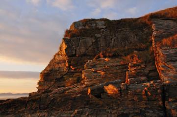Cliffs on a beach at sunset